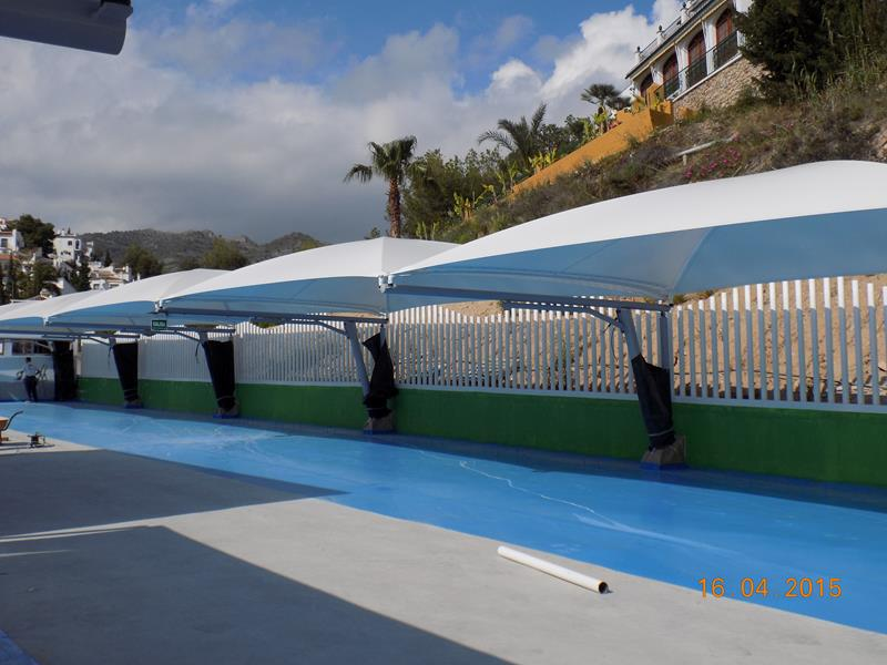 Textile and metallic parking canopies